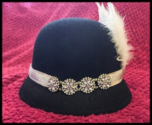 The finished DIY 1920s Headband on top of a black hat.