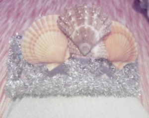 Gluing the seashells to the crown